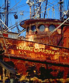 a very old and rusty fishing boat named Divine Guardian. Abandoned Ships, Abandoned Buildings, Abandoned Places, Fishing Boat Names, Fishing Boats, Port Isabel Texas, Rust Never Sleeps, Rust In Peace, Ghost Ship