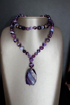 long purple agate necklace 76cm with a purple sliced agate pendant. on Etsy, $51.00
