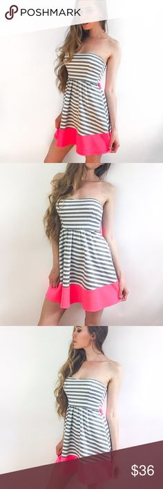 """Stripe Mini Dress NWOT. This is the cutest little dress. Grey and white stripes with neon pink features. Ties around the back for a tighter fit. Fits true to size. I'm a size small and modeling in the photo. Polyester and spandex material.   ▫️Add to Bundle"""" to add more items in my closet or """"Buy"""" to checkout here with your size.  ↓Follow me on Instagram ↓         @ love.jen.marie Jennifer's Chic Boutique Dresses Mini"""