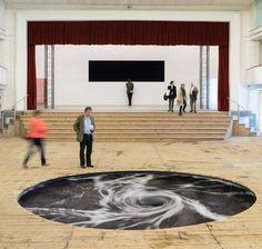 Anish Kapoor's Dark Whirlpool Installation Churns Ceaselessly Beneath An Old Movie Theater