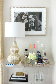 Bar Cart Styling Ideas - Bad Habit art print, exotic Python tray, mercury lamp, lucite bar cart, stacked books