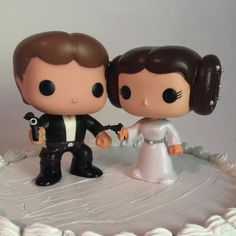 This adorable pair includes both. Han Solo and Princess Leia dressed in their best wedding outfits! I was inspired to paint these because they would be perfect for an awesome Star Wars themed wedding or even just a couple who are fans of the series!  Han wears a handsome black suit, white shirt, and black boots.  Leia wears a shimmering white dress and silver belt with pearl details in her hair and even a dazzling diamond ring!  Your cake would be the talk of the town, and your significant…
