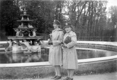 Two Nurses pertaining to the 203d GEN HOSP enjoy the sites of Versailles, France. Notice how both are carrying the Nurses' Utility Bag and wear the standard Wool Service Cap ~