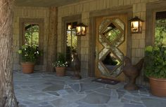 beautiful front entrance; note floor, detail on door, light fixtures....   Adirondack Style Boathouse