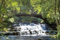 A waterfall under a bridge in Bosnia & Herzegovina.