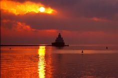 Manitowoc at Sunrise II by Christopher Franklin on Capture Wisconsin // Waiting for a special moment, the sun peaks through the clouds to start the day off right.