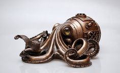 Objet de collection, Steampunk Octopus.  Fabriqué à partir dune base de résine avec une médaille de bronze enduit, peint à la main finition. Condition :