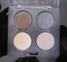 I pull out this palette for every look that I do. It's basically my workhorse palette, and you can tell by how dusty and scratched it is that I'm not very sentimental about it.    The eye shadows are:  - MAC Mystery: matte dark brown    - MAC Print: matte medium grey    - MAC Omega: matte, light beige grey.    - MAC Brule: yellow based beige.