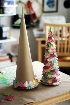 Making mini-Christmas trees out of cone-shaped paper mache. Cute. There's another idea using festive cupcake wrappers. This one uses tiny scraps of paper. Easy craft for the kids.