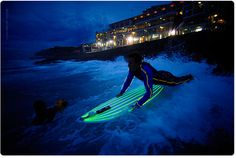 Night surfing with Tron suits with LED surfboards that glow. Wow --- just add some glow in the dark necklaces and bracelets to make it more fun!!!