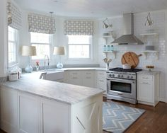 """How to keep white cupboards white? via Houzz: Lorna Hordos suggests removing a yellow tinge this way: Wash your cupboards with a fizzy mixture of 1 cup vinegar, 2 cups warm water and 1 tablespoon baking soda. To keep cabinets white, give them a monthly """"bath"""" with a solution of warm water and a grease-busting dish soap."""