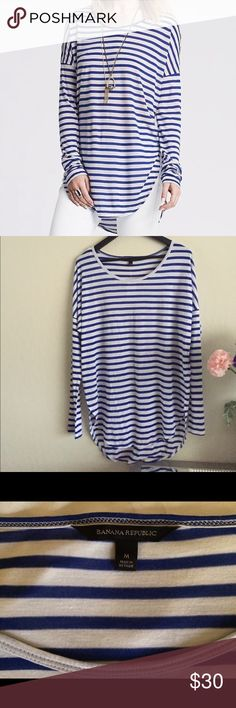 NWOT Size M Banana Republic striped long sleeve t This brand new blue and white striped long sleeve shirt is perfect for fall! Will fit a M-L. It's a soft shirt with dolman sleeves and a shirttail hem and rounded neckline. It has split sides and hits below the hip. 100% modal. Banana Republic Tops Tees - Long Sleeve