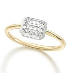 Jessica McCormack Signature Button Back emerald cut diamond engagement ring in yellow gold. #bridal #engagementring #diamond