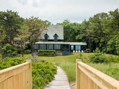 """Exquisite oceanfront living with panoramic views. This classic """"Beach cottage"""" offers a private boardwalk to a 7 mile pristine sandy beach. Enjoy spectacular sunsets and moonrises from this storybook setting. A true Maine treasure that shouldn't be missed.  http://www.legacysir.com/maine-real-estate/277-Seaside-Avenue-Saco-maine-04072/1143449/"""