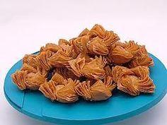 postre pastelitos del 25, masa de hojaldre relleno con dulce de membrillo o dulce de batata y se cocinan en aceite, son un manjar¡¡