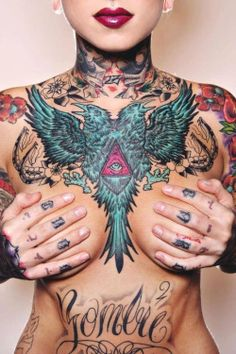 This model has some fantastic, and evil-looking, ink. #InkedGirls #chest #tattoo #eye #bird #snake #tattoos #inked