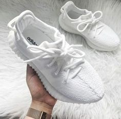 All white women's Yeezy sneakers. At TheShoeCosmetics all white trainers are the canvas, the fresh face to a sneaker makeover. An all white pair of Yeezy tennis shoes are perfect canvas for a customized sneaker. Moda Sneakers, Sneakers Mode, Best Sneakers, Sneakers Fashion, Fashion Shoes, 90s Fashion, Adidas Sneakers, Adidas Nmd, Fashion Jewelry
