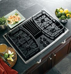 """gas downdraft cooktop example (GE profile, 30"""", $1,999); self-venting cooktop option for placement in island beneath vaulted ceiling (no hood) -- ensure building codes/covenants don't require hood"""