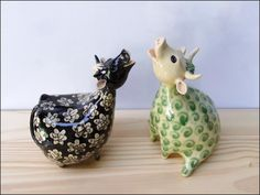 Hand modelled giraffes. Stoneware clay, decorated with oxides and fired to 1280°C If you like these maybe you'd like to visit my website gallery My ceramic animals are on facebook too and Google+