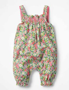 Our playsuits take a voyage into vintage with hand smocking and a pom-braid trim. Choose from pink florals, coral reefs or island friends to take along on baby's adventures. Cuffed legs keep things in place for little fidgeters, while inside-leg poppers make it super quick to pull off the suit when baby's done exploring for the day.