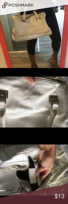White Express purse Cute white Express purse. There are a couple stains like from makeup that I just don't know how to get out. Hard to really see the stain tho when wearing the purse. Pet free/smoke free home. Ships in 1-2 days! Express Bags Satchels
