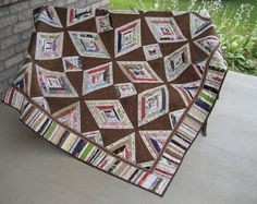 This fun lap quilt features selvages, fabric bundle braids, and scraps. The pattern is Red Zinger, by Karen Griska as featured in Quilter's Home Magazine.