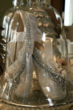Decorated pointe shoes under glass