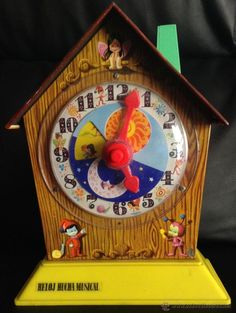 Reloj hucha musical a mi hermano se la regalaron en su comunión