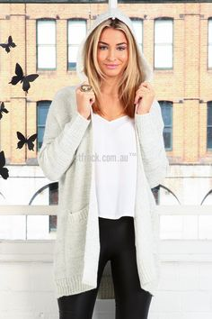 Night Owl Hooded Knitted Cardi $35.00  This snowy white cardigan is warm and snuggly, it makes for a great weekend piece. The (insert name) is a hooded open front cardigan with pockets you can pair with any homey casual look. It's made of a cozy knit that fits with room for comfort. Throw it over one of our Sound of Silence Maxis and grab a cup of tea for the comfiest weekend look ever!