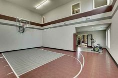 "Exclusive House Plan 73356HS, ""Big Daddy Sport Court House"", comes with this hoops court in the basement.   There's also an exercise room, bar, game room, family room and guest suite. And we're only talking about the lower level so far.  5 beds 4.5 baths 6,300+ sq. ft.  Ready when you are. Where do YOU want to play indoor hoops?"