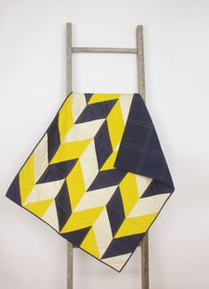 Baby quilt – Chevron/geometric - navy blue, yellow, white, modern, handmade, unique, play mat by abbeyshousequilts on Etsy https://www.etsy.com/listing/201216139/baby-quilt-chevrongeometric-navy-blue