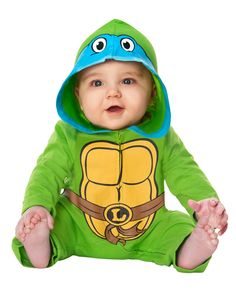 Teenage Mutant Ninja Turtles Leonardo Baby Costume exclusively at Spirit Halloween - Break him out of his shell in the Officially Licensed Teenage Mutant Ninja Turtles Leonardo Baby Costume. Your baby will lead the pack in this cozy green jumpsuit with shell and belt graphic, and Leonardo eye mask for only $24.99
