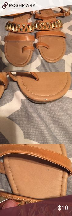 Tan sandals w/studs Tan sandals with gold studs. Little wear as pictured. Rouge Shoes Sandals