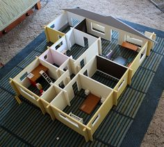 Filth Wizardry: DIY doll house. No instructions on site, but it would be easy to copy.