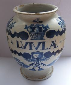 An English Delftware drug jar circa 1700. Painted with C:LVIVA as it was intended to hold Luiula or wood-sorrel