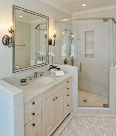The master bathroom hosts a marble vanity and glass shower. Photo: Liz Rusby/The Grubb Co.