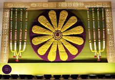 Floral decor with chakra backdrop for wedding . Floral Wedding Decorations, Engagement Decorations, Mehndi Decor, Mehendi, Indian Wedding Stage, Red Rose Wedding, Marriage Decoration, Wedding Mandap, South Indian Weddings