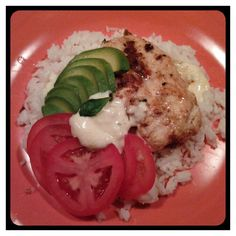 Delicious gluten free meal.  Sauteed chicken in coconut butter. Rice topped with homemade alfredo, slices of avocado and slices of tomato. Yum!