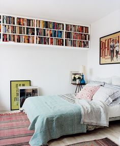 Love this long, high bookshelf in the bedroom // creative ideas for decorating with books