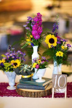 Vintage Book, Milk Glass, Sunflower Wedding  Centerpieces   FROM A VIBRANT BOHO GARDEN WEDDING AT FLINT HILLS DISCOVERY CENTER IN MANHATTAN, KANSAS