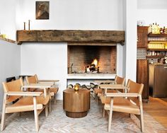 copenhagen, living rooms, fireplace mantles, mantel, front rooms, indoor fireplaces, denmark, leather chairs, wood beams