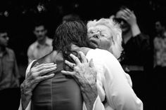 Groom embraces his grandmother at a wedding at Alberton House, Mt Albert, Auckland. Black and white.  BeSo Studios create beguiling fine art family photographs for the walls of the most discerning clients homes. We specialise in wedding and family portrait photography, and supply prints on the highest quality media, framed in beautiful conservation standard frames. We are a high end studio located in the beautiful city of Auckland, New Zealand.
