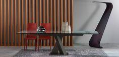 Table de repas AXEL - Roche Bobois <br>Table de repas avec 2 allonges de 40 cm intégrées. Base et pied central en acier, traverse en aluminium l'ensemble laqué époxy (7 coloris). Plateau en verre clair ou extra clair ép. 12mm.