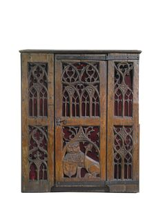 Gothic style carved oak cupboard