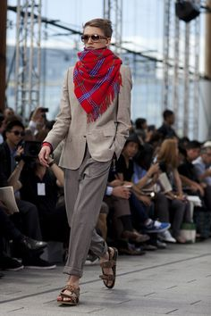 Reminds me a little of the men in Rajasthan who wear pin-stripe jackets and scarves in this manner.  I could pull this off!