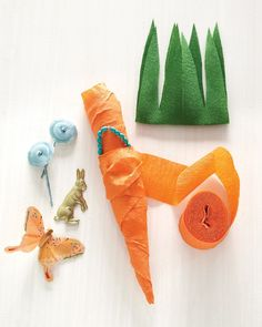 For our Easter party--tuck little gifts into these crepe paper carrots. Looks fairly simple, but with Martha, you never know!