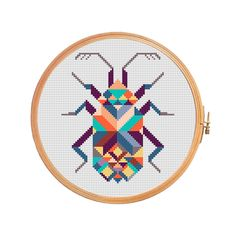 Amulet scarabaeus - cross stitch pattern geometric modern insect beetle Khepera Egypt  Floss: DMC Canvas: Aida 14 Grid Size: 67W x 77H Design Area: 4,64 x 5,36 (65 x 75 stitches)   Number of colors: 11  Use 2 strands of thread for cross stitch.  ONLY PATTERN! This PDF file counted cross stitch pattern is available for instant download.  This PDF pattern Included: - Color image of the finished design - Color Block Chart - Color Floss Legend with DMC stranded cotton.   In order to open these…