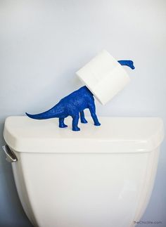 Dinosaur toilet paper holder! ♥ omg yesss