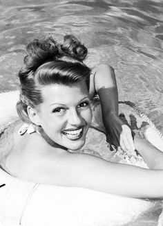 Rita Hayworth photographed in her pool, c. 1945.