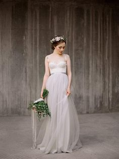 Milamirabridal's pale gray gown elegantly combines a fitted top and a flowing skirt. #etsyweddings